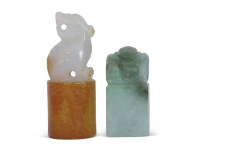 Chinese jade carving of a mythical beast on cylindrical base, together with a green jade seal, the