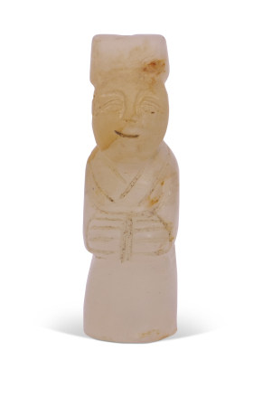 Chinese jade figure of an official seated on a circular base, 5cm long