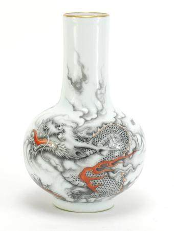 Chinese porcelain vase hand painted with a dragon chasing a flaming pearl amongst clouds, six figure