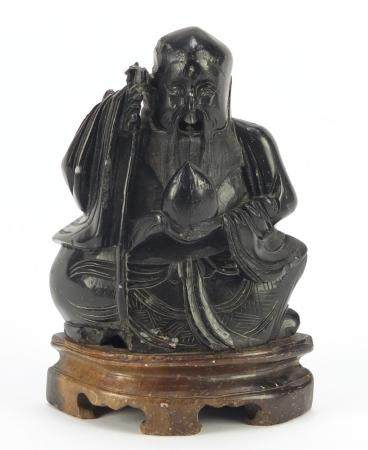 Chinese soapstone carving of an Elder holding a peach and staff, 14cm high : For Condition Reports