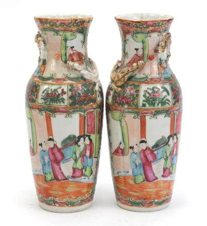 Pair of Chinese Canton porcelain vases with relief dragons, each hand painted in the famile rose