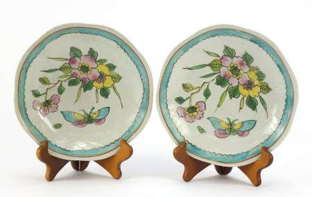 Pair of Chinese porcelain footed plates, hand painted with flowers and butterflies, each 20cm in