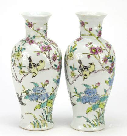 Pair of Chinese porcelain vases hand painted with birds amongst trees, iron red character marks to