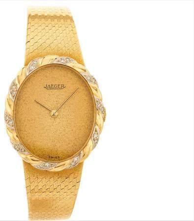 JAEGER VERS 1970N° 9528 - 21Montre bracelet pour femme en or jaune 18k (750), lunette en enroul