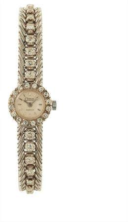 CODIA VERS 1960Montre bracelet pour femme en or blanc 18k (750), lunette sertie de diamants tai
