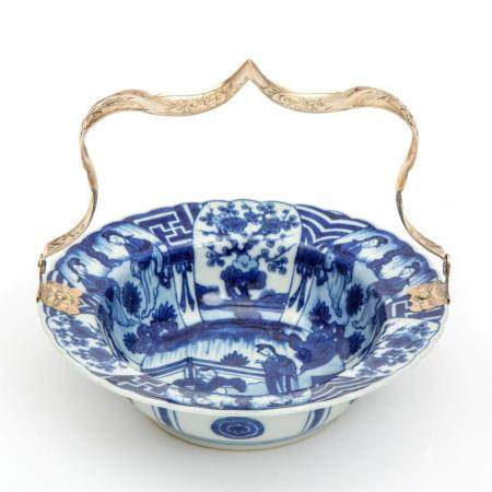 A blue and white Long Eliza bowl with silver handle