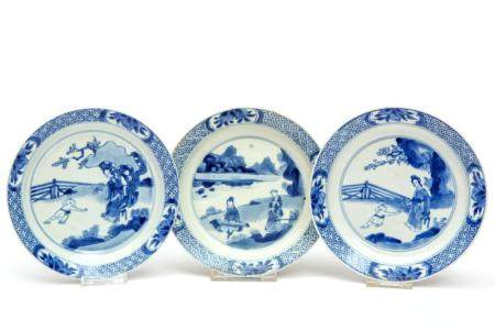 Three small size blue and white plates