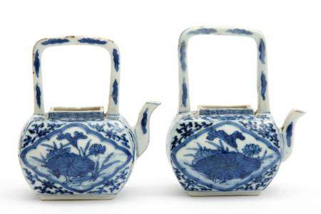 A pair of miniature arch handle teapots