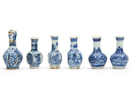 Six miniature blue and white vases
