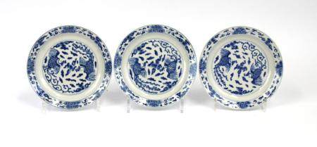 Three small size blue and white plates.