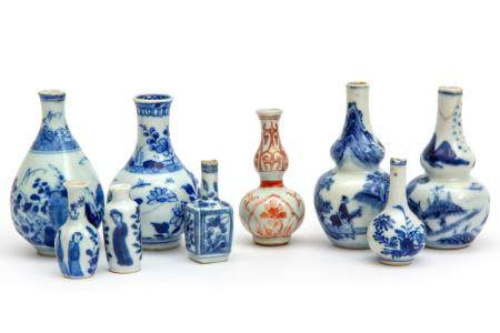 A collection of nine miniature or dolls house vases