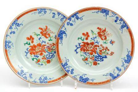 A pair of florally enameled plates