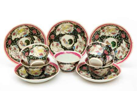 Five famille noire cups and saucers