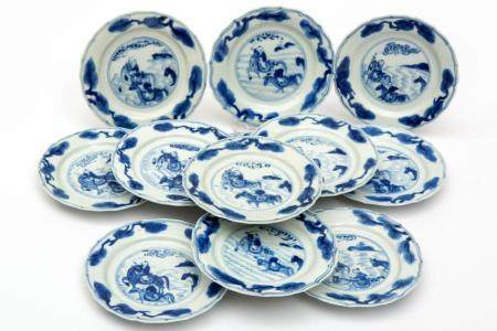 Twelve small blue and white plates, horses and figures