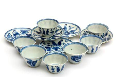 Five blue and white cups and saucers