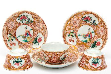 Three small size famille rose cups and saucers