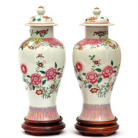 A pair of famille rose floral lidded vases