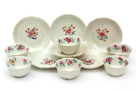 Six famille rose flower shaped cups and saucers
