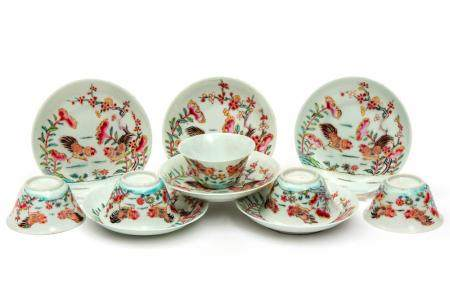Five famille rose cockerel cups and saucers