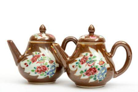 Two Batavia glazed and famille rose teapots