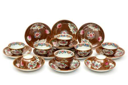 A Batavia glaze famille rose set of cups and saucers