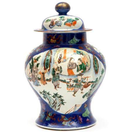 A famille verte covered vase on a blue ground