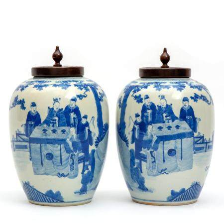 Two blue and white vases with wooden lids