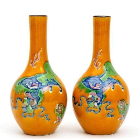 Two yellow glaze on biscuit sancai vases
