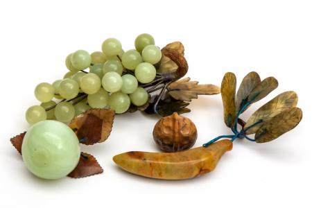 A selection of Chinese carved stone fruits