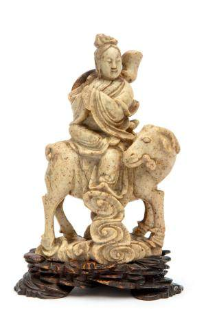 A carved soap stone figure