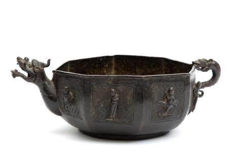 A Ming bronze octagonal bowl with figures in relief and drag