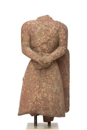 A red spotted sandstone male torso