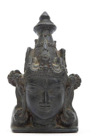 A black stone fragment of Surya