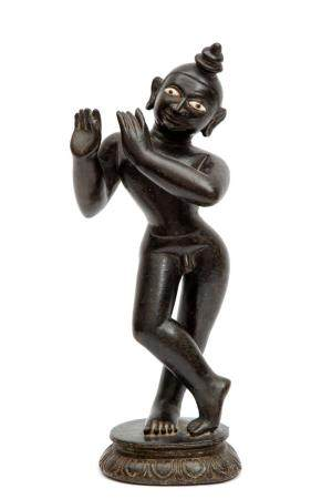 A black stone figure of Krishna