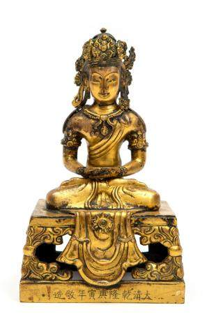 A Chinese gilded bronze figure of Amitayus