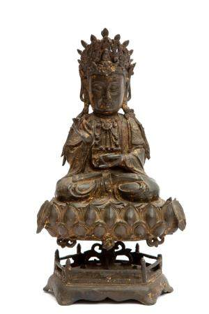 A Chinese bronze figure of Guanyin on a lotus stand