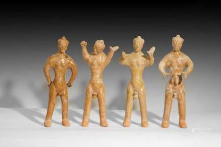 Groupe de 4 personnages en action, pourrait être des danseur