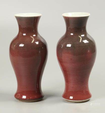 pair of Chinese oxblood porcelain vases, possibly Qing dynasty