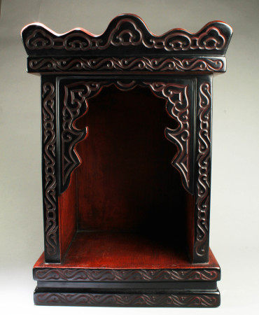 A Carved Lacquer Altar Cabinet