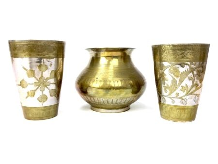 A PAIR OF INDIAN BRASS AND WHITE METAL BEAKERS AND A VASE