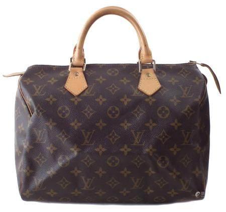A Louis Vuitton monogram Speedy 30 handbag,