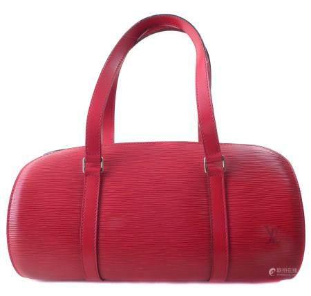 A Louis Vuitton red Epi Soufflot handbag and pouch,