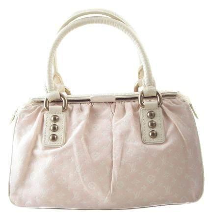 A Louis Vuitton Pink Monogram Trapeze PM Handbag,