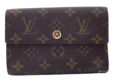 A Louis Vuitton Monogram Trifold Wallet,