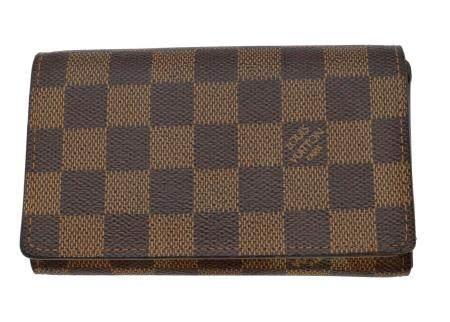A Louis Vuitton Damier Ebene Porte Monnaie Billets Tresor wallet,