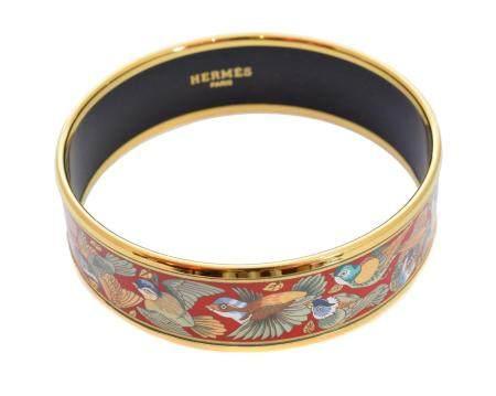 A Hermes 'Birds Species' gold tone enamel bangle bracelet,