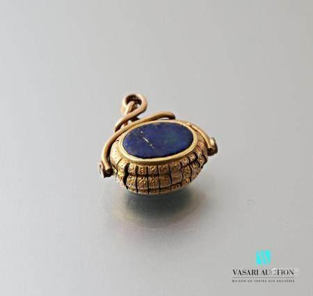 Cachet en or 585 millièmes ovale mobile serti de lapis-lazuli, poids brut 8 g.