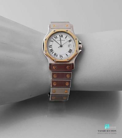 CARTIERSantos, montre bracelet de dame en acier et or. Boîtier de forme octogonale avec lunette