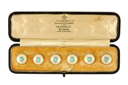 A cased set of turquoise and mother of pearl studs