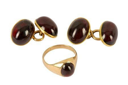 A pair of garnet cufflinks and garnet set gold ring